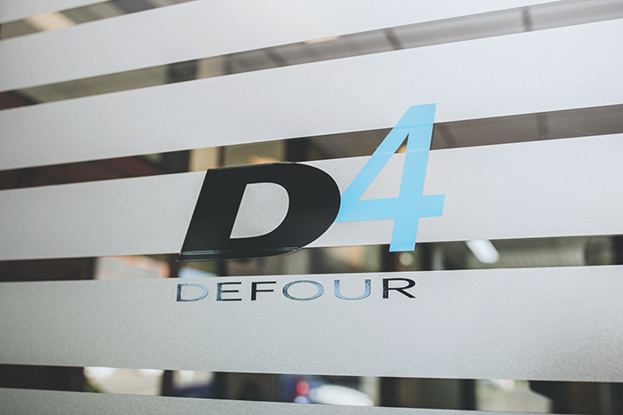 Defour logo taping on the front door.